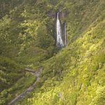 "Hidden Kauai waterfalls that were featured in the movie ""Jurassic Park"" as viewed from a helicopter tour"