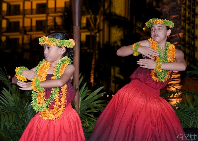 Young girls perform the Hawaiian hula