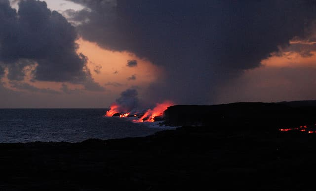 View of lava flowing into the ocean