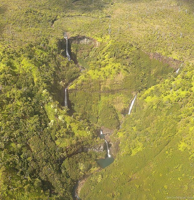 A view from a helicopter of remote Kauai waterfalls.