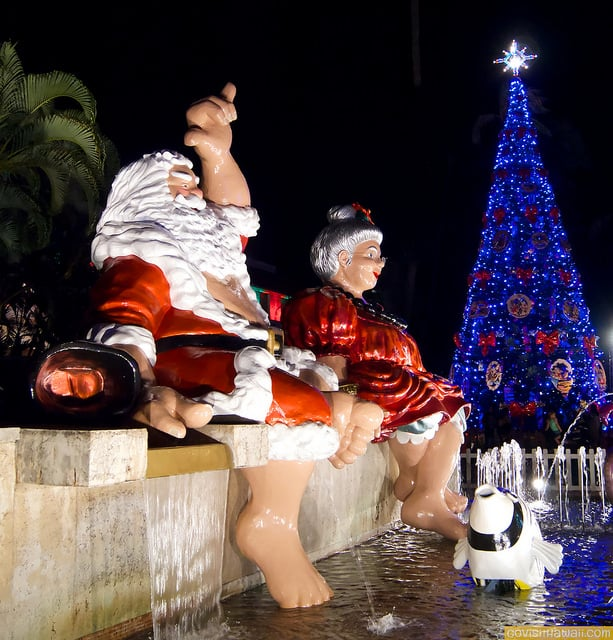 Shaka Santa and Mele Tutu by the Christmas tree in front of Honolulu Hale presented as part of Honolulu City Lights