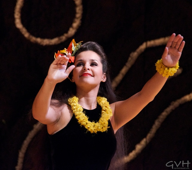 A graceful hula dancer at a luau